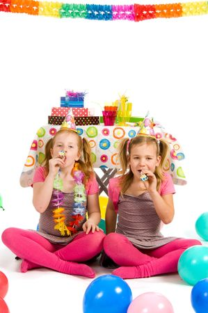 blowers: Girls with party blowers on a birthday party