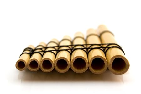 panpipe: Closeup of a panflute on a white background