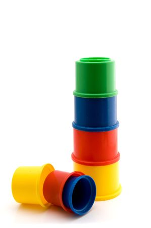 stackable: Tower of colorful cups as a toy for little children on white