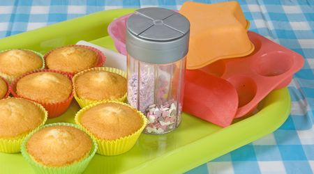 Table with cupcakes and baking accessoires Stock Photo - 6607130