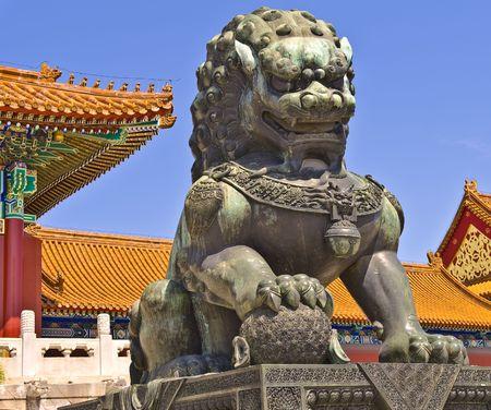 Bronze lion near the entrance to Emperor Temple in Forbidden City