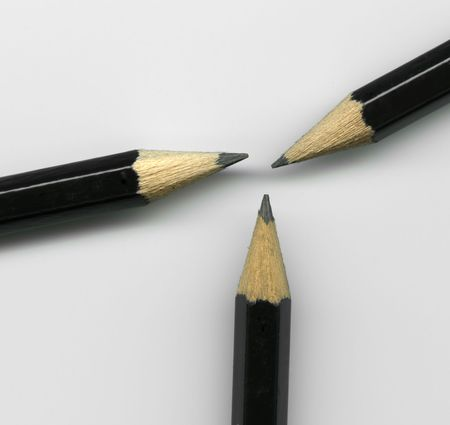 Extreme close up of three sharpened pencil tips