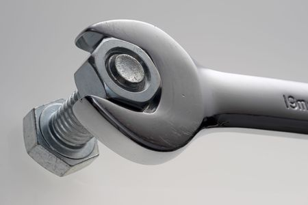 Extreme close up of a wrench, nut, and bolt Stock Photo