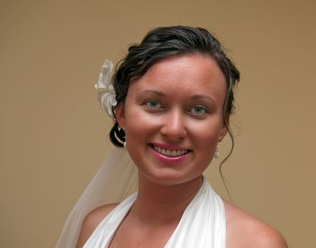 Portrait of young bride indoor setting before ceremony