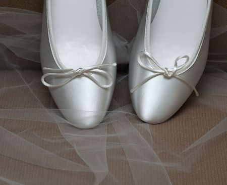 shoes on wedding veil on tip toes Reklamní fotografie