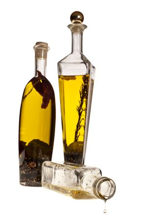 LAst drop of oil image on white background with bottles of oil at second plane Stock Photo - 5194322