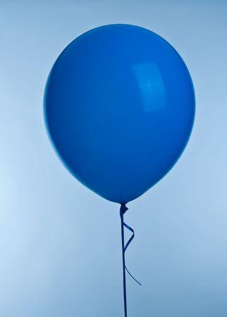 One blue ballon image on blue background Stock Photo