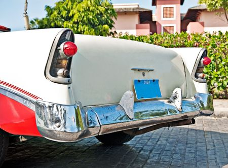 A 56 red and white chevy that is driven on the road in cuba Stock Photo