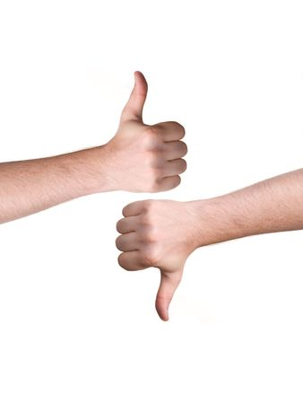 man hand showing thumbs up and down sign  Stock Photo
