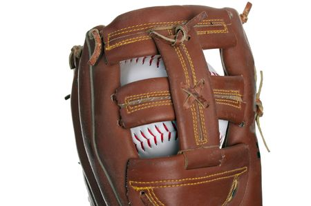 baseman: making a catch in a baseball game with a fielders glove