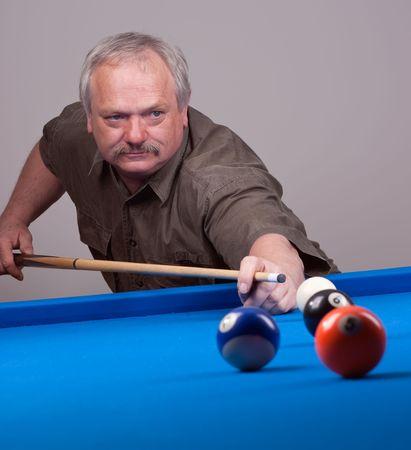 man shooting pool balls during a billiard game