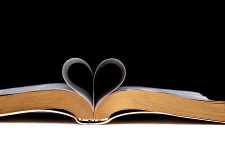 Book pages shaped as heart Stock Photo