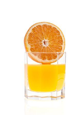 Glass of orange juice, and orange on white background