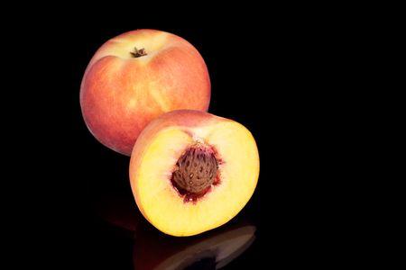 Two fresh peaches image on the black background Stock Photo