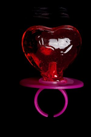 teat: Baby teat in heart shape on black background Stock Photo