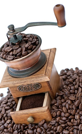 Old coffee grinder with beans