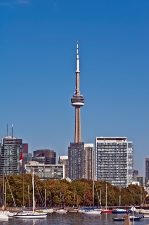 blue panoramic skies above Toronto CN Tower overlooking the luxury high rise apartments along the harbour waterfront of Lake Ontario, Toronto, Canada. photo