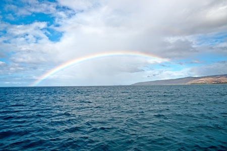 Beautiful rainbow in Hawaii, Pacific ocean. shoreline of Kauai Island