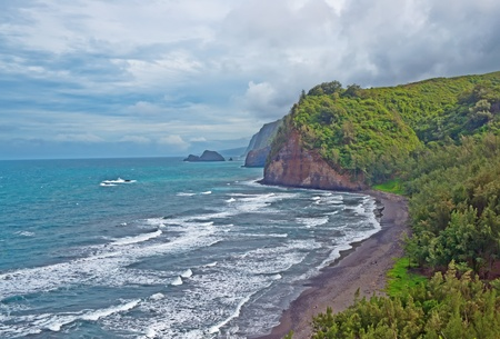 Pololu Beach on the Big Island of Hawaii. Passing the 28 mile marker on Highway 270 past Hawi it is a breathtaking view of Polulu Valley. It