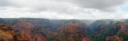 View into the Waimea Canyon on Kauai, Hawaii (the Grand Canyon of the Pacific). Panorama image five photos combine