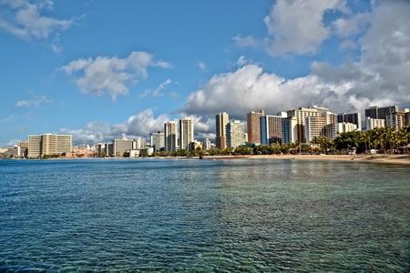 Cityscape Waikiki Beach, Honolulu Hawaii, USA.  Waikiki beach is a popular spot in the city of Honolulu to swim, surf, and relax Stock Photo