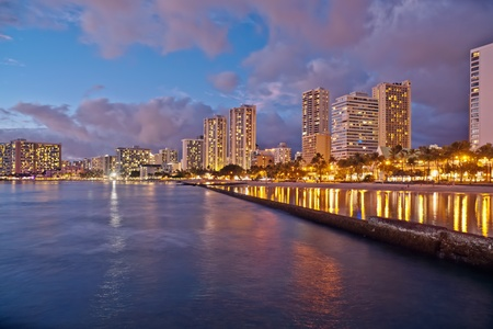 Cityscape Waikiki Beach, Honolulu Hawaii, USA.  Waikiki beach is a popular spot in the city of Honolulu to swim, surf, and relax Stock Photo