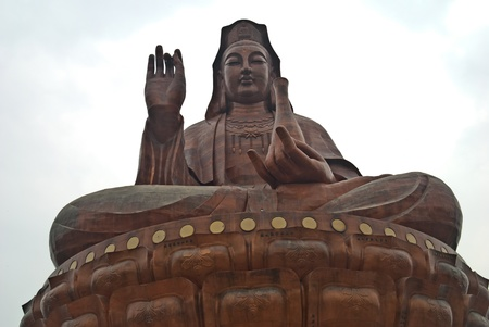 The holy statue of Kwan-yin is grand and gorgeous. The statue is about 61.9 meters (about 203 feet) high, implying that Kwan-yin achieved perfection on June 19th. Kwan-yin sits in her holy seat of lotus flowers, with a merciful light shining in her eyes.