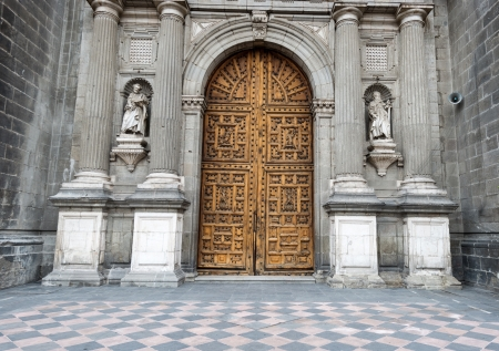 Wooden entrance doors to The Metropolitan Cathedral of the Assumption of Mary of Mexico City  It  is the oldest and largest cathedral in the Americas and seat of the Roman Catholic Archdiocese of Mexico