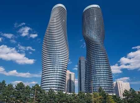 The Absolute World condominium Towers in the city center of Mississauga Ontario on a sunny afternoon  The hourglass shaped tower has been nicknamed the Marilyn Monroe tower due to the curvy shape