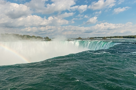 the edge of horseshoe falls: Rainbow rises from the mist at Horseshoe, Niagara Falls, Ontario, Canada