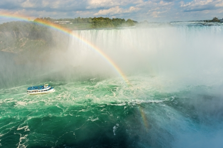 Rainbow rises from the mist at Horseshoe, Niagara Falls, Ontario, Canada