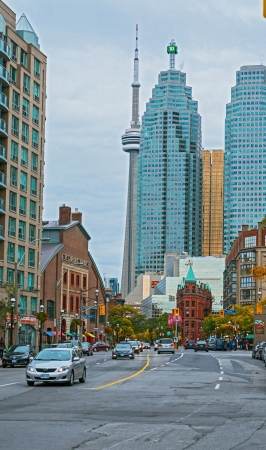 roberts: Toronto, Canada - October 07, 2012  Torontos landmark Flatiron Building, a restored late 19th century Victorian office building built by architect David Roberts Jr  In the background  the two office towers and the CN tower  Picture is taken in  the after