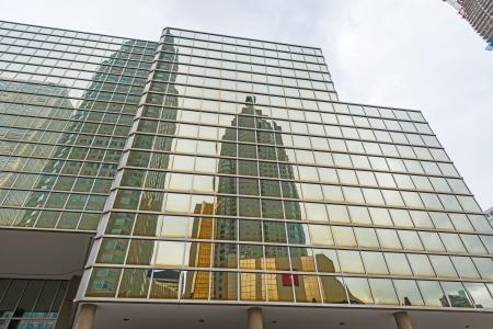 Toronto skyscrapers reflection on glass windows on Bay st
