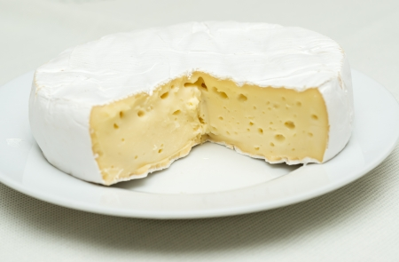 Cheese plate, a kinds of cheese served on a platter  Фото со стока