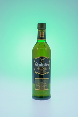 12 year old: Kitchener, Canada - December 30, 2012  A 12 year old bottle of Glenfiddich Single Malt Scotch Whiskey  Glenfiddich means meaning  valley of the deer , this single malt whisky has been distilled in Speyside sine 1887  Editorial