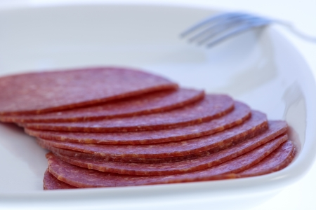 Salami slices on plate