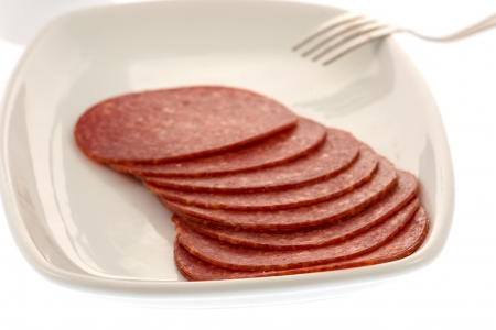 Salami slices on plate