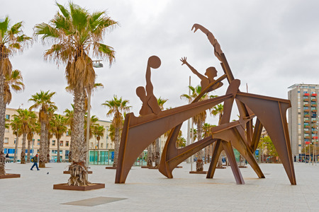 Barcelona, Spain - January 25, 2014   Olympic sculptures on Plaza del Mar in Barcelona, Spai on sunny day in January 25, 2014