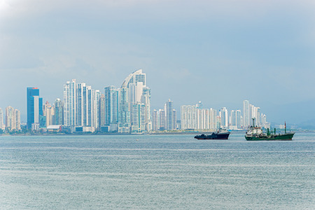 Shipping boats in Panama Bay on the background  Panama City skyscrapers skyline  Sunny day in January 2, 2014