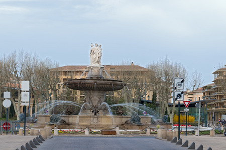 napoleon iii: Aix en, France - March 30, 2014  Early morning urban living by Fountain de la Rotonde in Aix en, Provence, France on March 30, 2014  The fountain was designed by Napoleon III Editorial