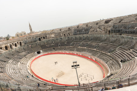 1st century: Nimes, France - March 30, 2014  Panoramic view at the inside of the 1st century BC amphitheatre in Nimes, France on March 30, 2014