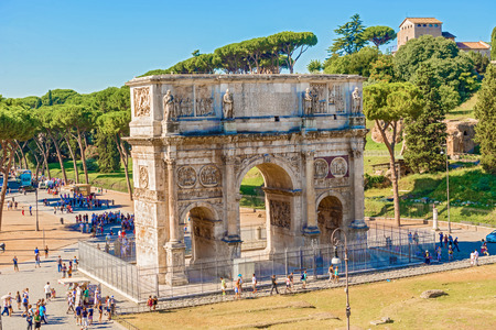 constantine: Rome, Italy - August 29, 2014: Tourists visiting Arch of Constantine in Rome, Italy in August 29, 2014.