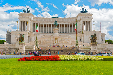 tourists stop: Rome, Italy - September 1, 2014: Piazza Venezia one of the nerve centres of Rome, and important hub of city traffic and stop off point for tourists. Main attraction is monument to Victor Emanuel II