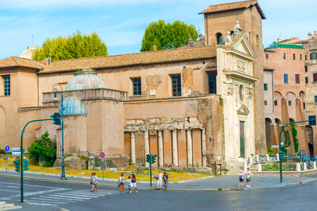 to incorporate: Rome, Italy - August 31, 2014: Tourists walking by Church of San Nicola in Carcere  in Rome on Augustb 31, 2014. Its outer walls incorporate remains of columns taken from three Roman temples. Editorial