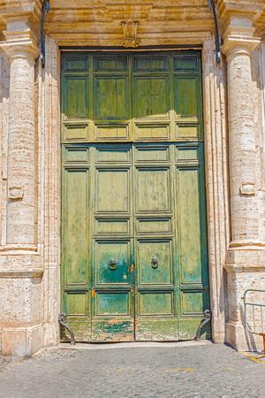 ferro: Old entrance doors to the public building near Piazza Capo di Ferro in Rome, Italy. Stock Photo