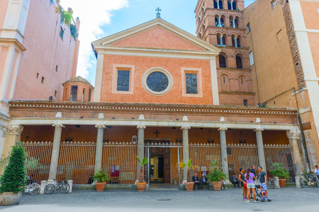 matron: Rome, Italy - September 3, 2014: Tourists in front of  church dedicated to Saint Lawrence, Roman deacon and martyr. The name Lucina comes from the fourth century Roman matron, that gave permission for Christians to build a house of worship.