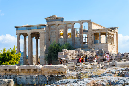 greece granite: Athens, Greece - September 8, 2014: Tourists sightseeing the ruins of Erechtheion temple on Acropolis Hill, Athens Greece. Editorial