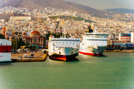 ferries: Pireus, Greece - September 8, 2014: Big ferries boats in the passenger port of Piraeus, Athens.