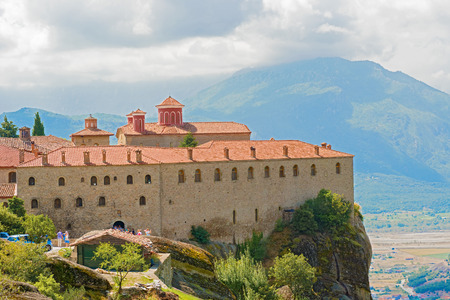 kalambaka: Kalambaka, Greece - September 9, 2014: Tourists visiting The Holy Monastery of St. Stephen, Meteora Greece. It has small church built in the 16th century. Nuns took it over and reconstructed it.