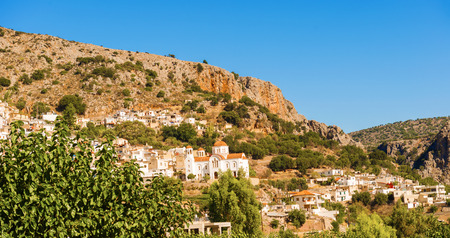 Panoramic view at town of Kritsa. It is one of the oldest and most picturesque villages in Crete, Greece, built amphitheatrically on a rock hill, named Kastellos, surrounded by olive groves, at an altitude of 375 m. Imagens